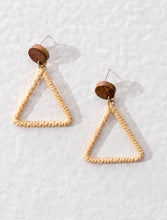 Hollow triangular earrings made of raffia and wood. All natural and eco-friendly, yet contemporary.