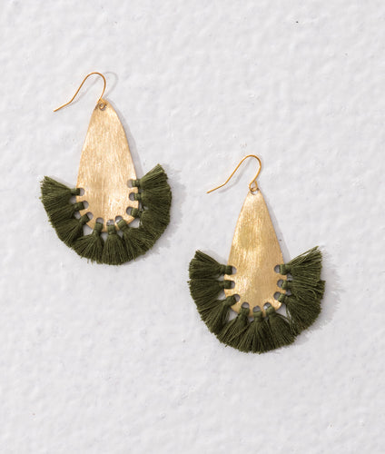 Statement earrings made of textured brass and olive green tassels. Stylish ethical jewellery.