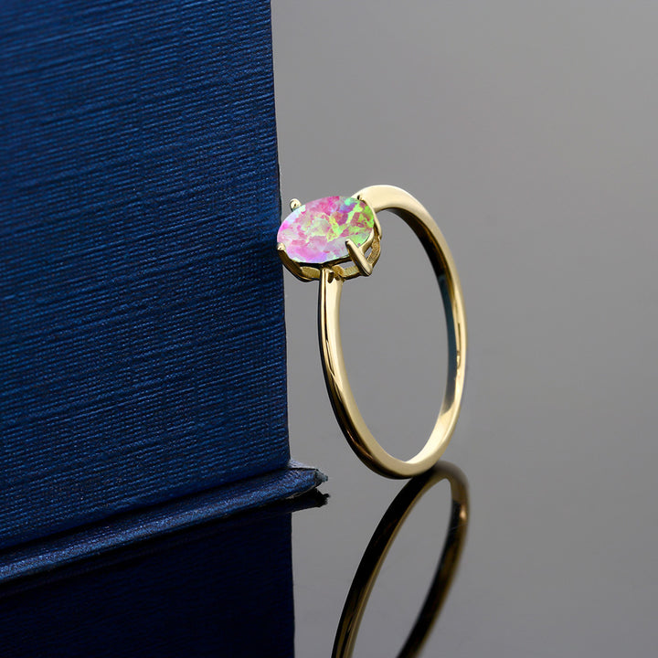 0.63 Ct Oval Pink Simulated Opal 10K Yellow Gold Solitaire Engagement Ring