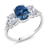 Gem Stone King 10K White Gold Diamond Accent Three-Stone Engagement Ring set with 2.35Ct Oval Blue Mystic Topaz White Topaz
