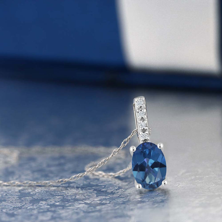 Women's Oval Blue Mystic Topaz 14K White Gold Diamond Pendant With Chain