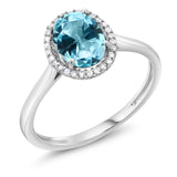 10K White Gold Diamond Halo Engagement Ring Set with Oval Ice Blue Topaz from Swarovski (Available 5,6,7,8,9)