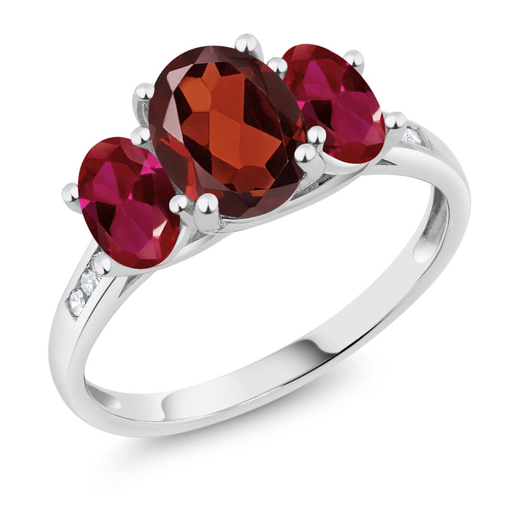 Gem Stone King 10K White Gold Diamond Accent Oval Red Garnet Red Created Ruby 3-Stone Ring 2.20 Ct (Available 5,6,7,8,9)