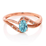 10K Rose Gold 0.79 Ct Oval Blue Zircon and Diamond Engagement Bypass Ring