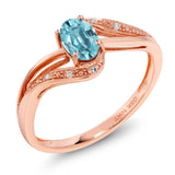 Gem Stone King 10K Rose Gold 0.79 Ct Oval Blue Zircon and Diamond Engagement Ring