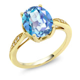 Gem Stone King 14K Yellow Gold 2.74 Ct Oval Millennium Blue Mystic Quartz and Diamond Ring