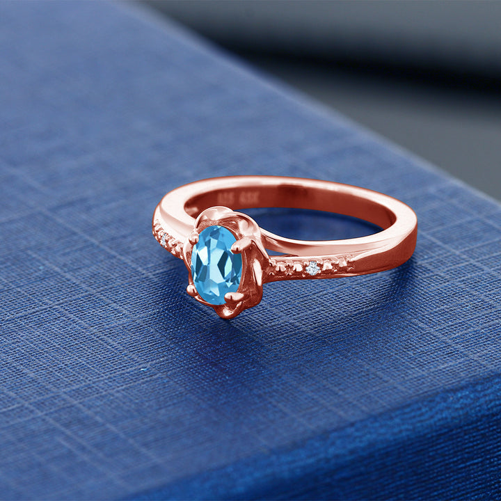 0.52 Ct Oval Swiss Blue Topaz 18K Rose Gold Plated Silver Ring