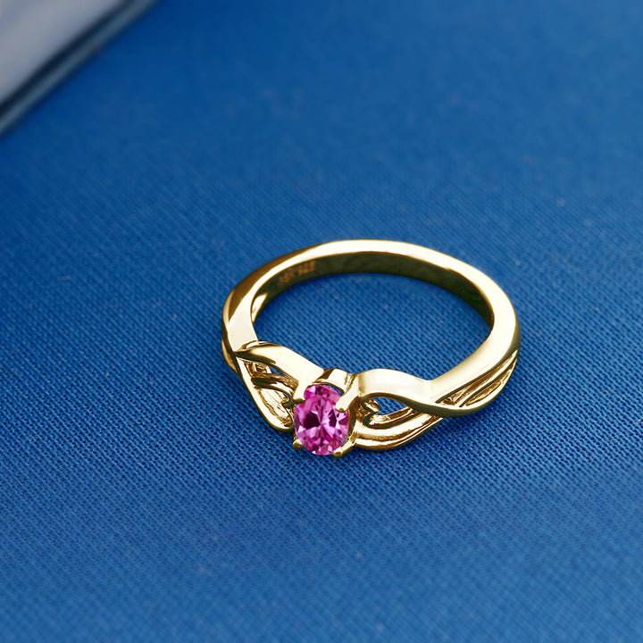 0.50 Ct Oval Pink Created Sapphire 18K Yellow Gold Plated Silver Ring