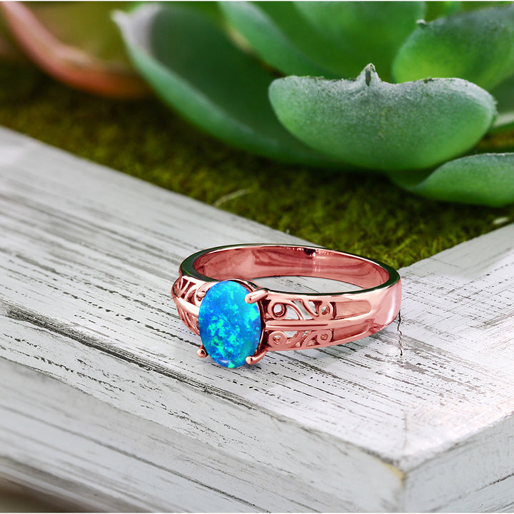 1.05 Ct Oval Cabochon Blue Simulated Opal 18K Rose Gold Plated Silver Ring