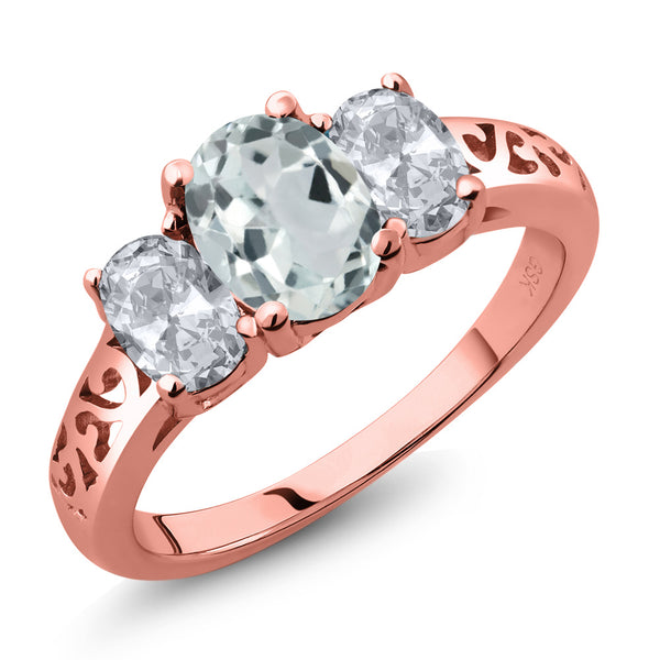Gem Stone King 2.10 Ct Oval Sky Blue Aquamarine White Topaz 18K Rose Gold Plated Silver 3 Stone Ring