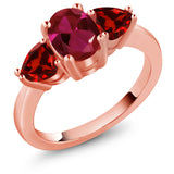 Gem Stone King 2.23 Ct Oval Red Created Ruby Red Garnet 18K Rose Gold Plated Silver 3 Stone Ring
