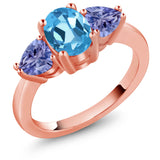 Gem Stone King 2.20 Ct Oval Swiss Blue Topaz Blue Tanzanite 18K Rose Gold Plated Silver 3 Stone Ring