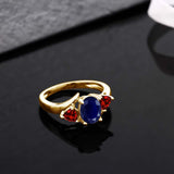 2.47 Ct Oval Blue Sapphire Red Garnet 18K Yellow Gold Plated Silver Ring