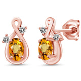 Gem Stone King 1.13 Ct Oval Yellow Sapphire White Diamond 18K Rose Gold Plated Silver Earrings