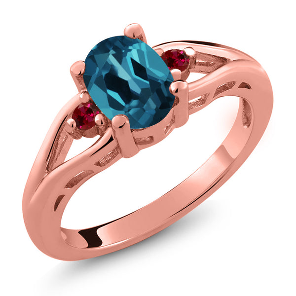 Gem Stone King 1.40 Ct Oval London Blue Topaz Red Created Ruby 18K Rose Gold Plated Silver 3 Stone Ring