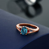 1.40 Ct Oval London Blue Topaz Red Created Ruby 18K Rose Gold Plated Silver Ring
