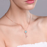 1.57 Ct Round Sky Blue Topaz 18K Rose Gold Plated Silver Key Pendant
