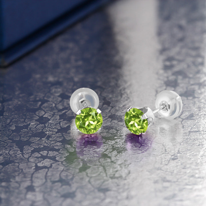 0.60 Ct Round Green Peridot 10K White Gold 4-prong Stud Earrings 4mm
