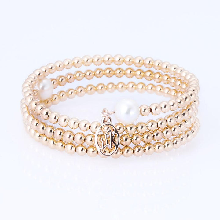 4mm Simulated Shell Pearl  Wrap Around Adjustable Rose Tone Bracelet With Charm