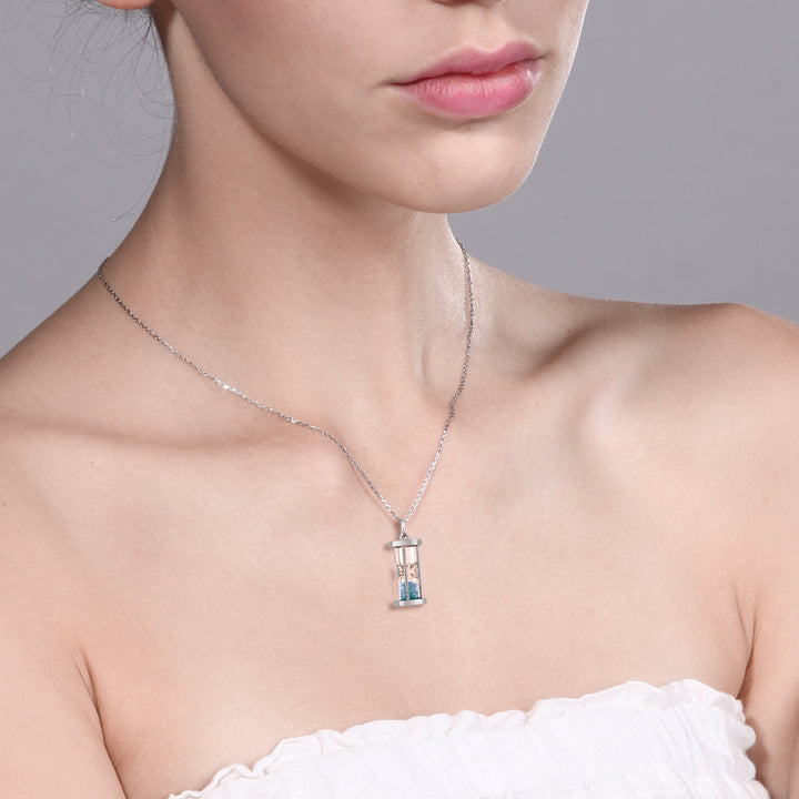 "925 Silver Hourglass Pendant with 0.75 Ct Blue Topaz Dust 18"" Chain"