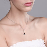 "925 Silver Hourglass Pendant with 0.75 Ct Garnet Dust 18"" Chain"