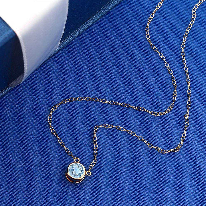 0.70 Ct Round Sky Blue Topaz 14K Yellow Gold Pendant With Chain