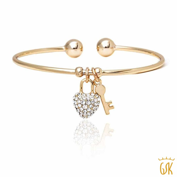 db75729bb5c0e Yellow Gold Plated Open Bangle Bracelet with Heart and Key Shape Pendant