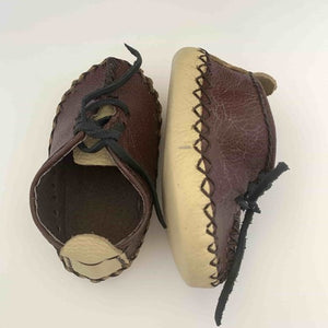 Brown and cream gender neutral hand stitched baby moccasin shoes with laces - mystic world finds
