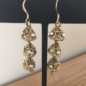 sparkly dangly gold and diamond earrings