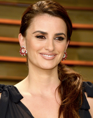 Penelope Cruz wears an impeccable Ruby and Diamond Crescent Earrings