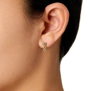 model wearing San Shi Peridot Stud Earrings, Sterling Silver - Tsai x Tsai | Luxury Gemstone Jewellery Gift