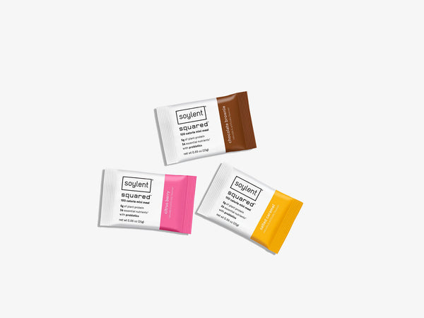 citrus berry , salted caramel and chocolate brownie soylent squared meal replacement bar  on a white background