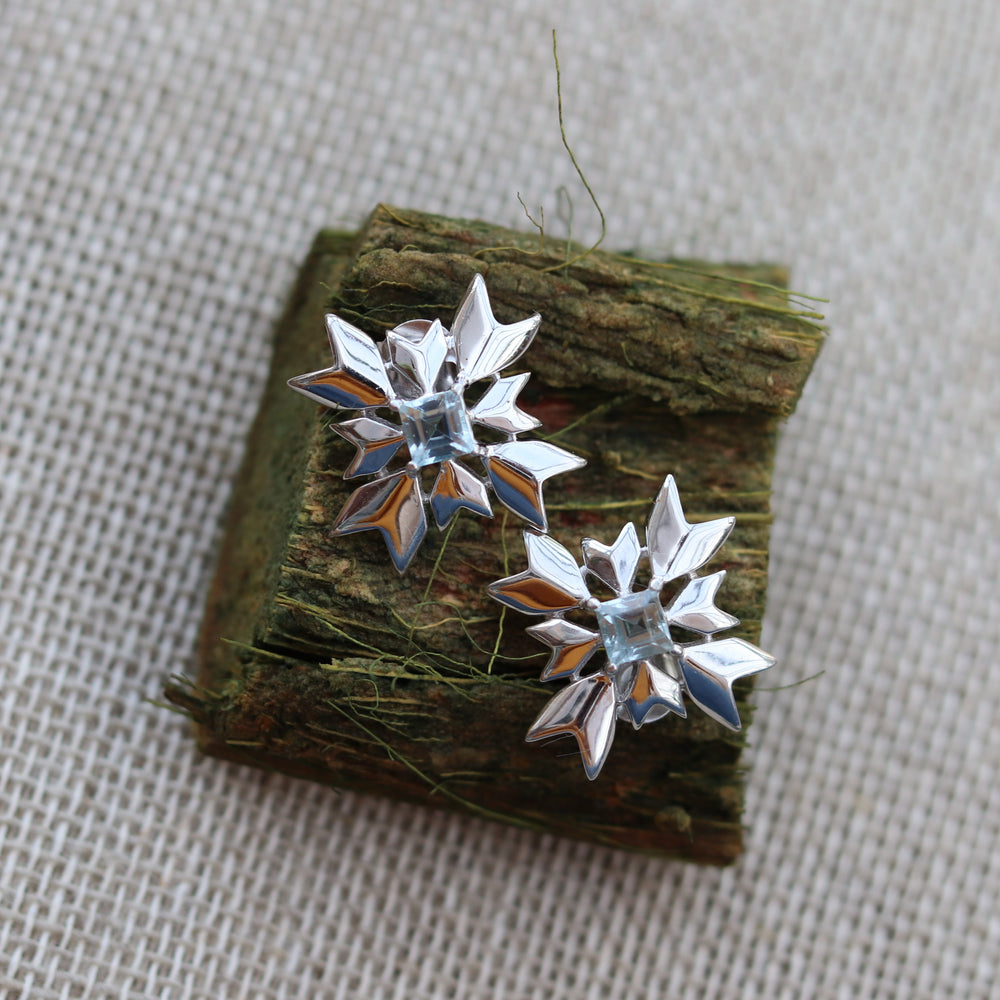 Artisan Snowflake Sterling Silver Stud Earrings with Blue Topaz