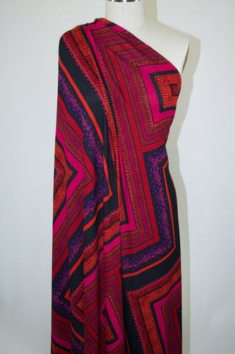 1 1/8+ yards of Ziggin and Zaggin Bold Scaled Sweater Knit - Reds/Purples/Black