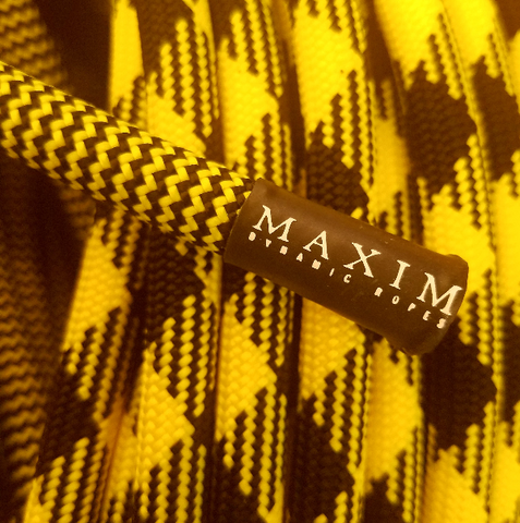 closeup showing detail of maxim climbing rope pinnacle yellow jacket bipattern bicolor yellow jacket weave end of rope tag logo