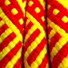 closeup of sterling dynamic climbing ropes evolution helix 9.5 60m red and yellow pattern