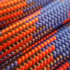 closeup of maxim pinnacle rope showing detail of 1x1 weave of nylon fibers blue orange tan colors cobalt option dry treated rope