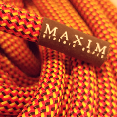 closeup of maxim dynamic climbing rope airliner end of rope tag maxim climbing ropes logo