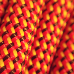 Closeup of Maxim Airliner Afterburner Afterburner colored rope showing detail of 1x1 weave colors red yellow black