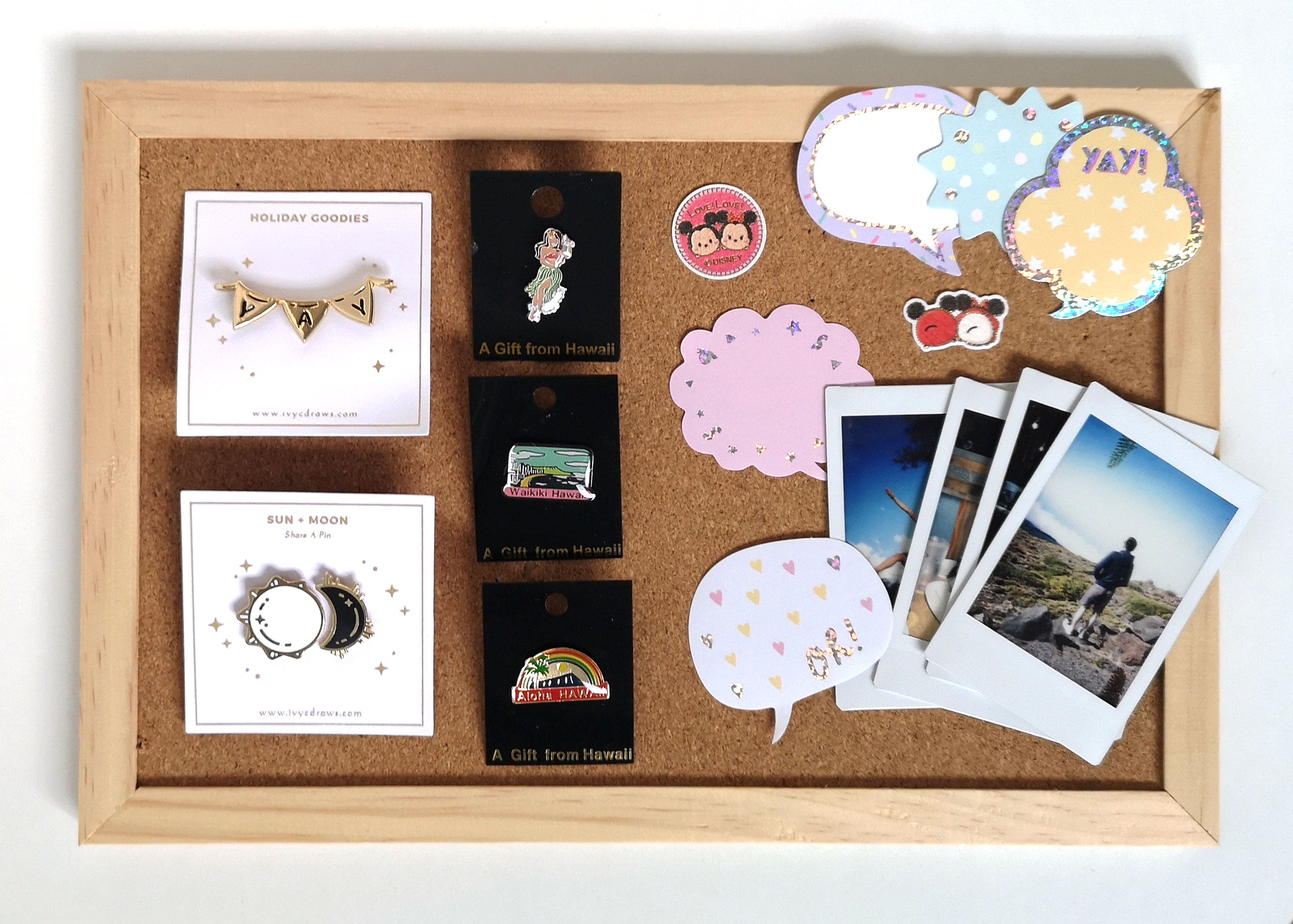 enamel pins, stickers, souvenirs, and polaroids