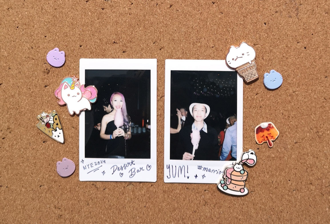 Polaroid pictures decorated with enamel pins