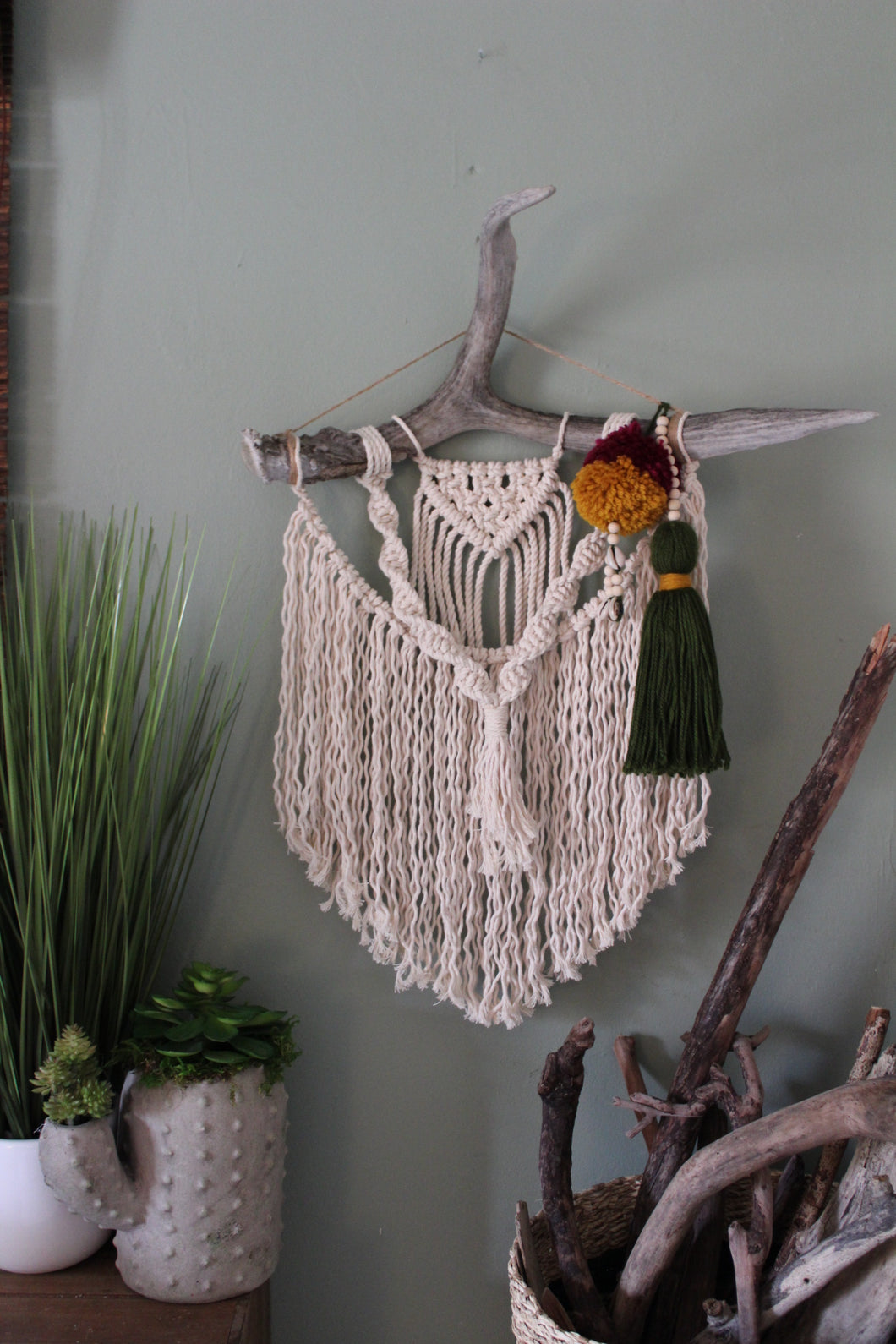 Macrame deer antler with pom pom accent