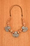 Mud yellow coffee mask necklace