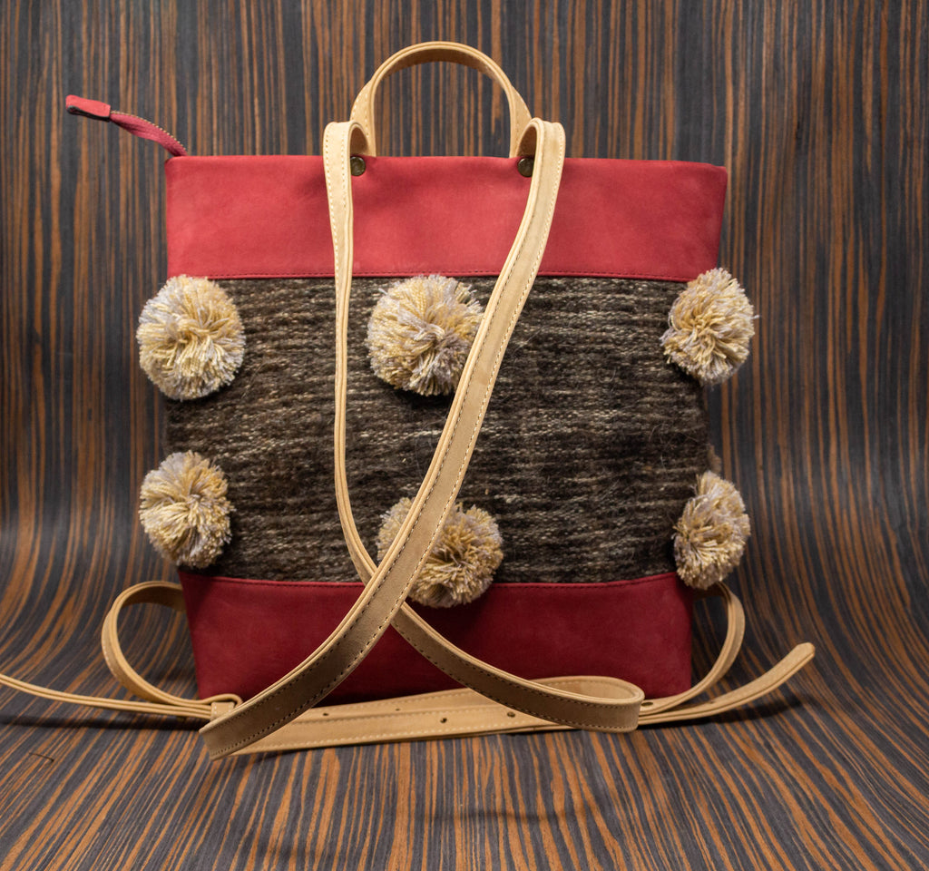 Wine leather backpack with straps and Chamula café textile handle with cream pompoms - TOCO MADERA - Handcraft shoe from Mexico - Handmade shoe