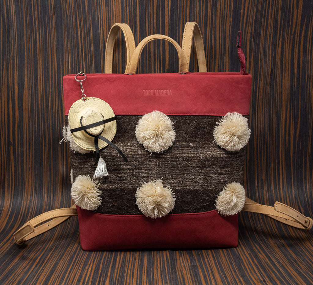 Wine-colored leather backpack with straps and Chamula café striped textile handle with cream pompoms - TOCO MADERA - Handcraft shoe from Mexico - Handmade shoe