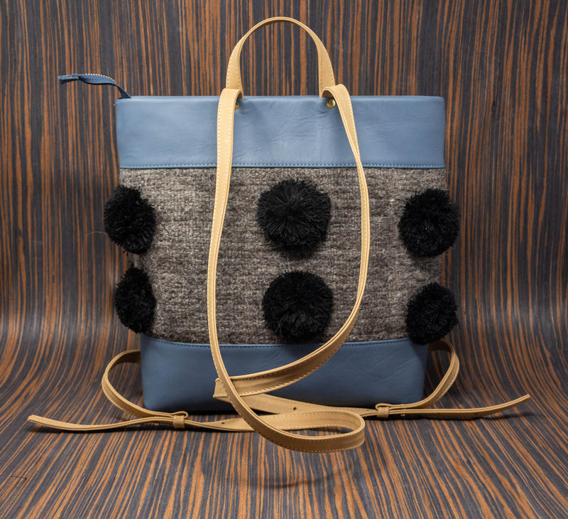 Blue leather backpack with straps and gray Chamula textile handle with black pompoms - TOCO MADERA - Handcraft shoe from Mexico - Handmade shoe