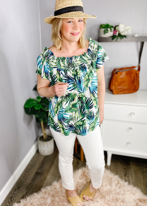 Smocked tropical off the shoulder top with short sleeves. Soft  flowy fabric.