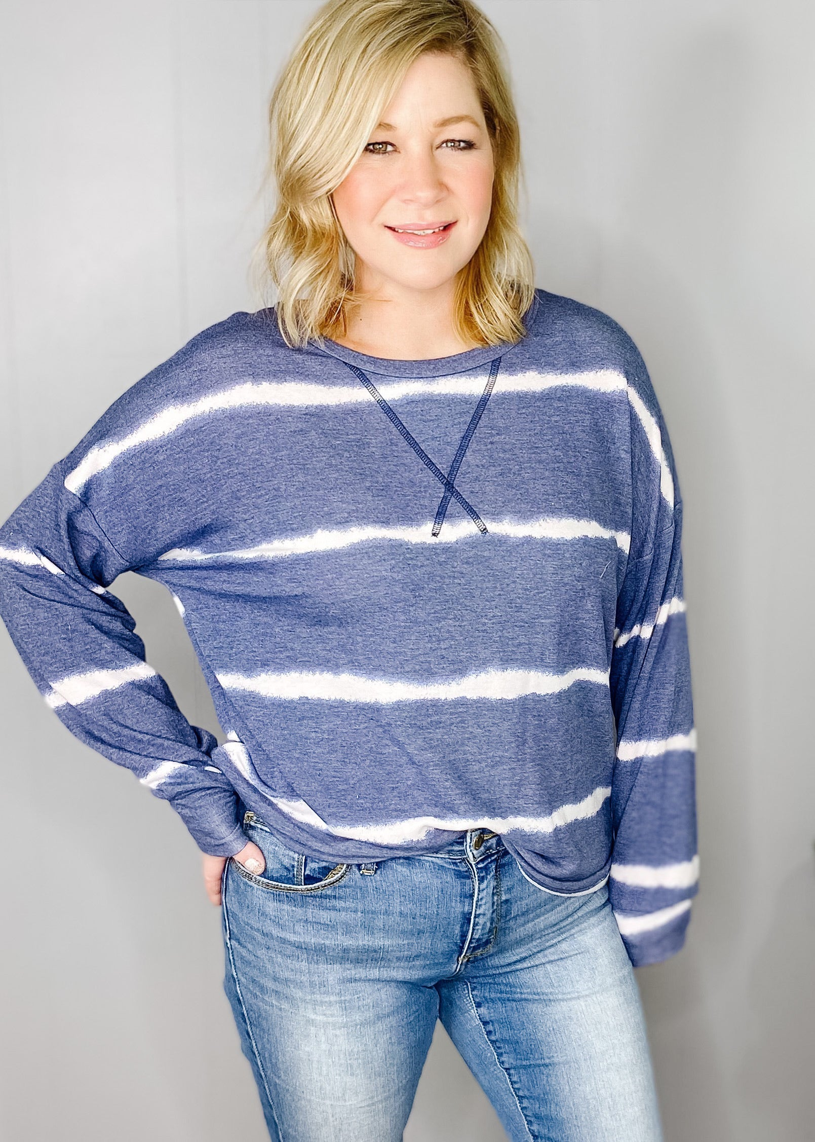 Navy Top with white tie dye stripes. Long sleeves, medium weight and stitch detail. Available in small, medium, large and x large at L.E & CO BOUTIQUE.     f