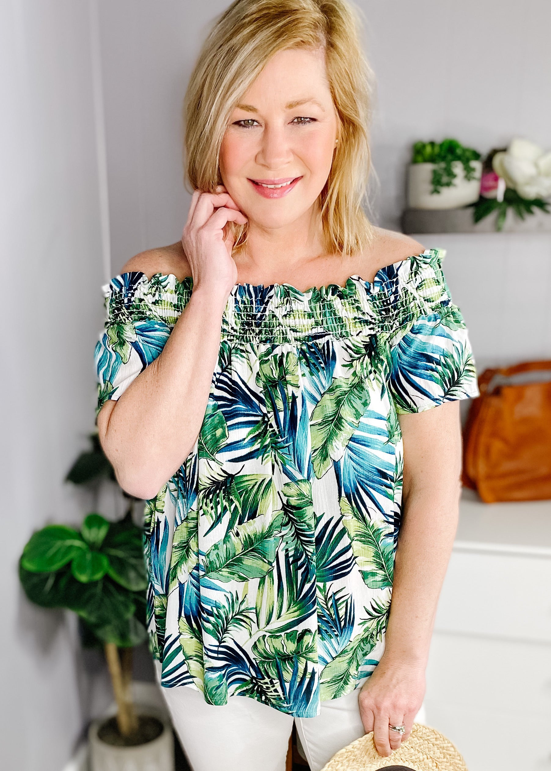Tropical off the shoulder top. Amazing blues and greens in the tropical pattern, smocked feature around shoulders, short sleeves and straight hem.