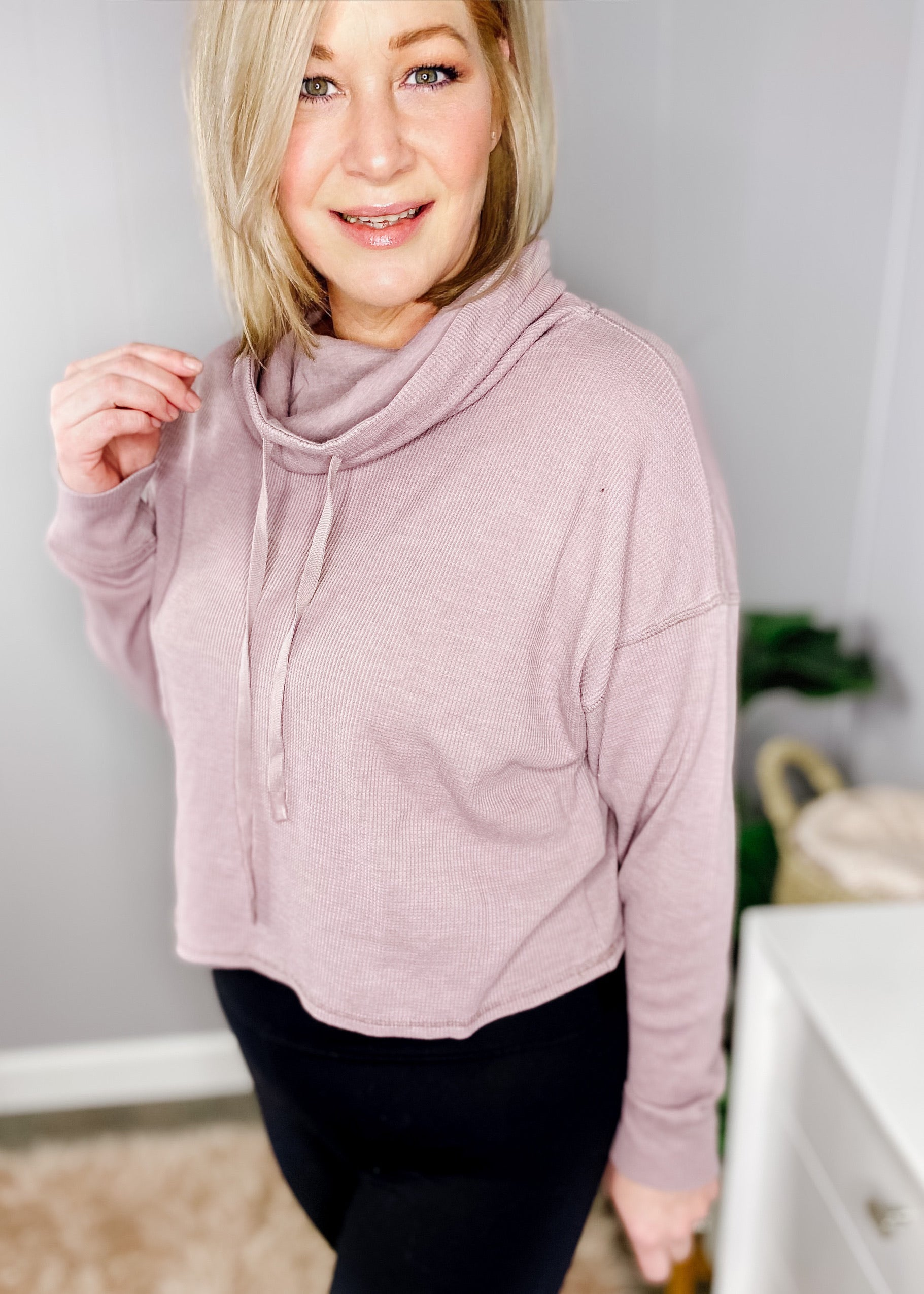 boxy pullover with mineral wash finish in dusty pink. Long sleeves shorter length.